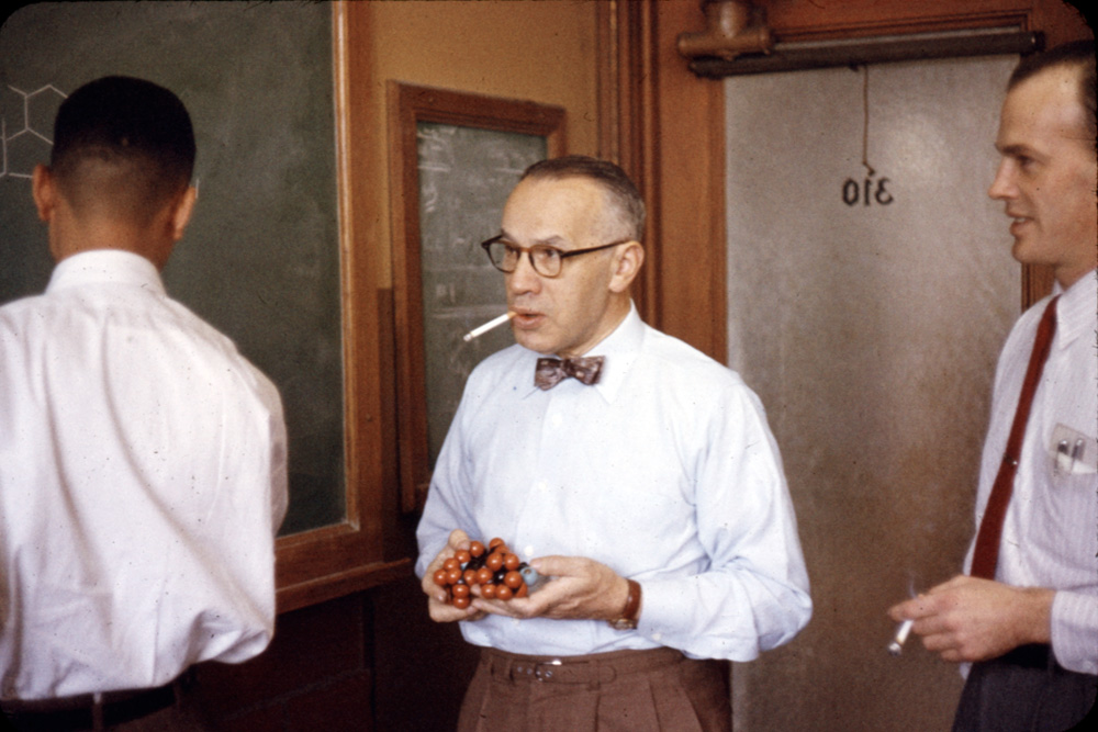 Morris S. Kharasch (center), the Carl William Eisendrath Professor of Chemistry (1935-1953) and the Gustavus F. and Ann M. Swift Distinguished Service Professor (1953-1957) at the University of Chicago. Mr. Kharasch is pictured teaching.